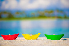 Colorful paper boats on tropical white beach Royalty Free Stock Photo