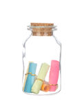 Colorful paper in the bottle with cork isolated on white Royalty Free Stock Images