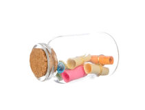 Colorful paper in the bottle with cork isolated on white Royalty Free Stock Image