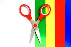Colorful paper with child's scissors Royalty Free Stock Images