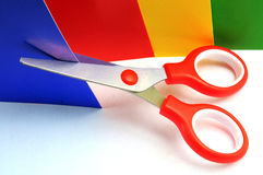 Colorful paper with child's scissors. Child's scissors cut a paper Stock Photo