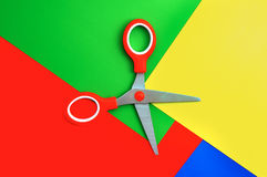 Colorful paper with child's scissors. The top view Royalty Free Stock Photography