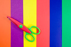 Colorful paper with child's scissors Royalty Free Stock Photo