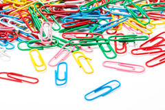 A colorful paper clip against Royalty Free Stock Photos