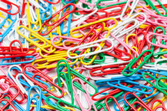 A colorful paper clip against Royalty Free Stock Photography