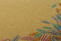Colorful paper clip on the brown board Stock Images