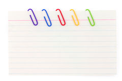 Colorful paper clip with notepaper Stock Images
