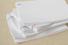 Colorful paper clip with pile of overload document and reports Stock Images