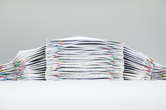 Colorful paper clip with pile of report Stock Images