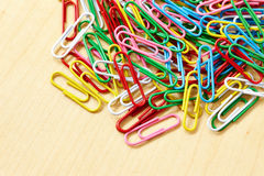 Colorful paper clip on table Stock Photos