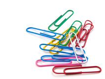 Colorful paper clip on white background. Royalty Free Stock Photo