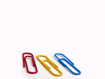 Colorful paper clip on white background. Stock Photo