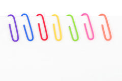 Colorful paper clip and white paper Stock Photography