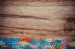 Colorful Paper Clip. On wood board royalty free stock images