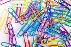 Colorful paper clips on the whit background royalty free stock photography