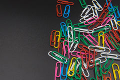 Colorful Paper clips isolated on black background. Stock Photography