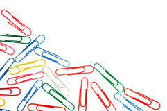 Colorful paper clips isolated on white with copy space Stock Photos