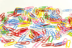Colorful paper clips. Red green pink yellow white blue Stock Photos