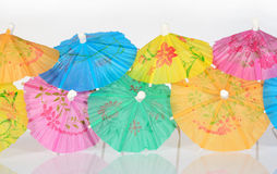 Colorful paper cocktail umbrella Stock Images