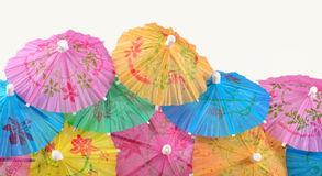 Colorful paper cocktail umbrella close-up on a white Stock Images