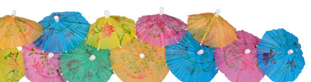 Colorful paper cocktail umbrella close-up on a white Stock Image