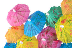 Colorful paper cocktail umbrella close-up on a white Royalty Free Stock Images