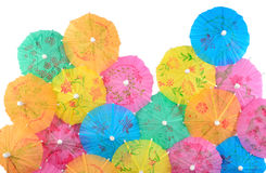 Colorful paper cocktail umbrellas close-up on a white Stock Photo