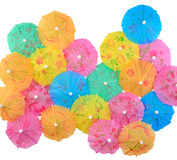 Colorful paper cocktail umbrellas close-up on a white Royalty Free Stock Images