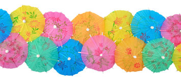 Colorful paper cocktail umbrellas close-up on a white Royalty Free Stock Image