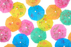 Colorful paper cocktail umbrellas close-up on a white Royalty Free Stock Photos