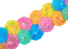 Colorful paper cocktail umbrellas close-up on a white Stock Images