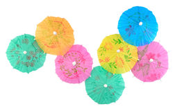 Colorful paper cocktail umbrellas close-up on a white Stock Image