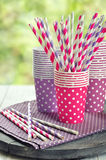 Colorful paper cups and striped straws Stock Photography
