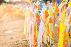 Colorful paper flag with sand in tradition Songkran festival. Colorful paper flag with sand in tradition of carrying sand into the temple or monastery during Stock Photo