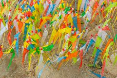 Colorful paper flag in the temple sand heap in Songkran festival. Northern culture in Thailand Royalty Free Stock Photo