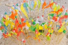 Colorful paper flag in the temple sand heap in Songkran festival. Northern culture in Thailand Stock Photo