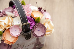 Colorful Paper Flower in handbag flowerpot.  Royalty Free Stock Images