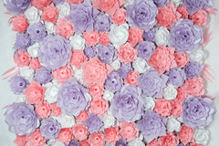 Colorful paper flowers background. Floral backdrop with handmade roses for wedding day or birthday. Colorful paper flowers background. Floral backdrop with Stock Photos