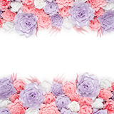 Colorful paper flowers background. Floral backdrop with handmade roses for wedding day or birthday. Stock Photo