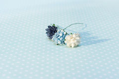 Colorful paper flowers lay on paper with polka dots Royalty Free Stock Photography