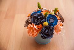Colorful Paper Flowers in a small bucket.  Stock Photos