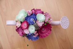 Colorful Paper Flowers in a small pink handshower Stock Photo