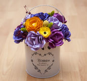 Colorful Paper Flowers in a small white bucket Stock Photo