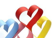 Colorful paper hearts. On white royalty free stock images