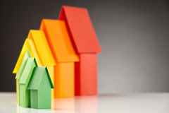Colorful Paper Houses. Seven small paper houses in the colors of the energy efficiency label royalty free stock images