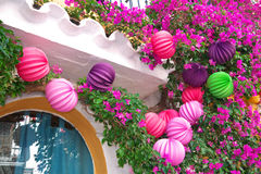 Colorful paper lanterns and Bougainvillea Royalty Free Stock Photo