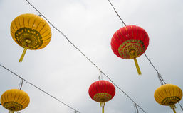Colorful paper lanterns hanging together Royalty Free Stock Photos
