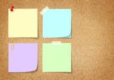Colorful paper note. On cork board royalty free stock image