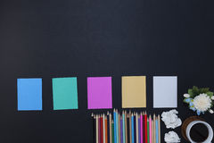 colorful paper note with pencil and coffee cup,flower on black l Stock Photos