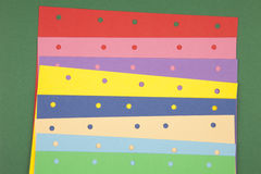 Colorful paper notes. With holes Royalty Free Stock Photo